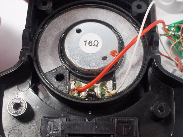 Place the right speaker console face up with the four speaker terminals situated below the 16 Ohm speaker like so.