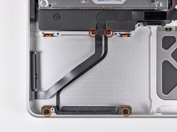 Image 1/1: Remove the following four screws securing the hard drive/IR sensor cable to the upper case: