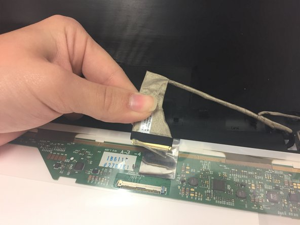 On the back of screen, lift up the plastic film and screen connector. Pop out the connector, and gently remove the screen.