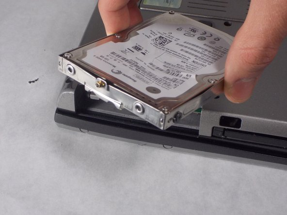 Carefully pull hard drive out.