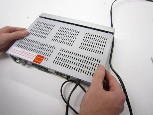 Image 3/3: Slide the casing backwards.