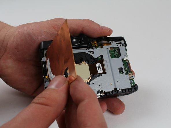 Image 2/2: Lift and remove the copper EMI shield.