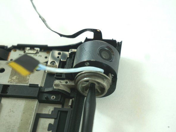 Use the pointed end of a spudger to push in the camera's locking mechanism.
