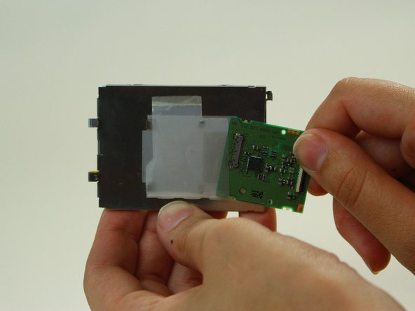 Image 1/1: Connect the new screen with the green circuit board ensuring you use the tweezers to connect it fully into the port.