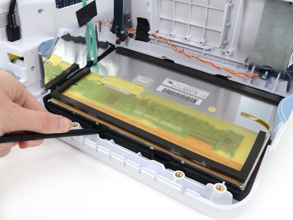 Use the flat end of a spudger to lift the LCD out of the rubber gasket frame.