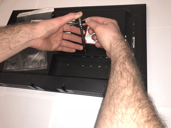 Use the Phillips 00 Screwdriver to remove all the Phillips Head Screws from the the backside of the TV.