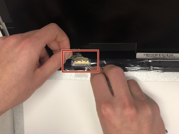 Pull the gold ribbon cable to disconnect the screen from the laptop.