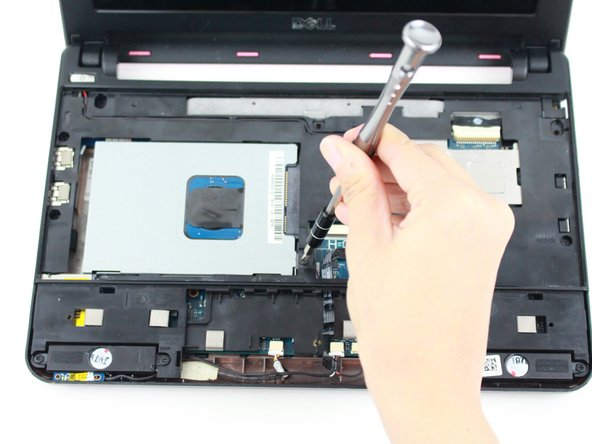 Remove the single 8mm screw attaching the hard-drive cage to the body of the device.