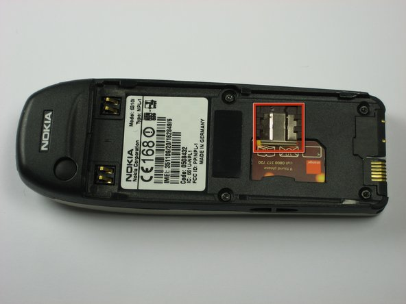 Slide the SIM card lock away from the SIM card.