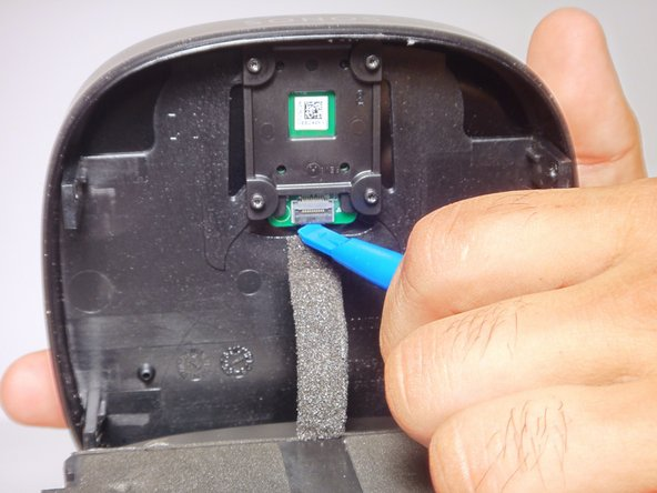 Image 1/2: Once flap is loosened, use your hand to remove the circuit wire.