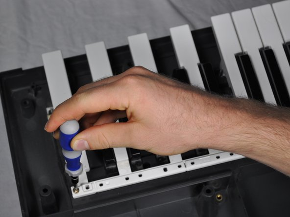 Replace the group of broken keys with new ones and screw all of the keys back in place.