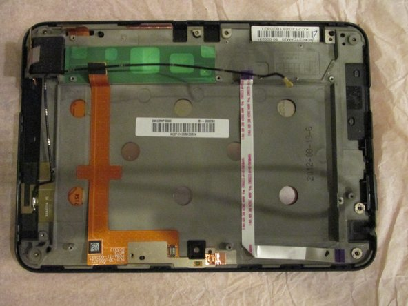 Image 1/1: Remove the motherboard and speakers from the gray casing.