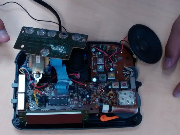 Gently pull out (without pulling the wires apart) the speaker and smaller circuit board.