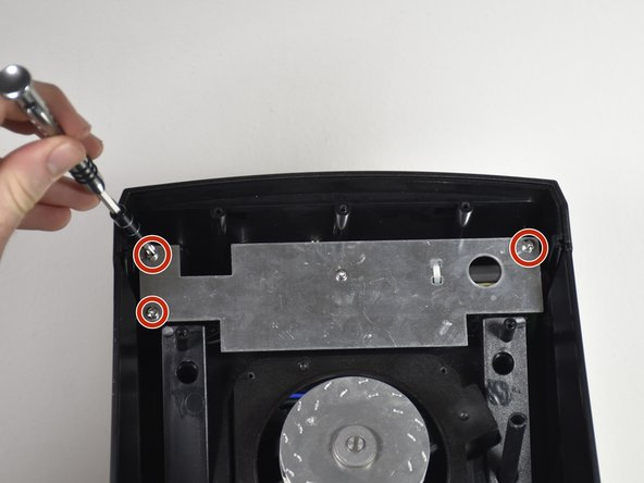 Unscrew the three Phillips #2 9mm screws.