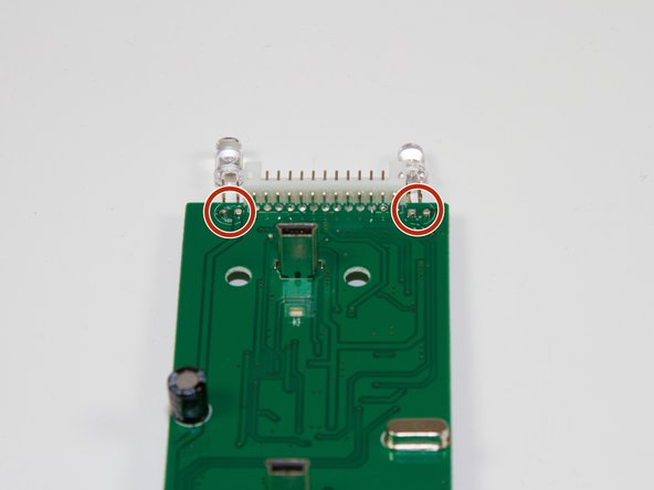 Desolder the two points following the instructions included in your soldering kit as you remove the light.