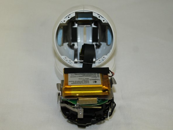 Gently remove the lens/battery bundle from the base of the circle, being mindful of the ribbon cable.