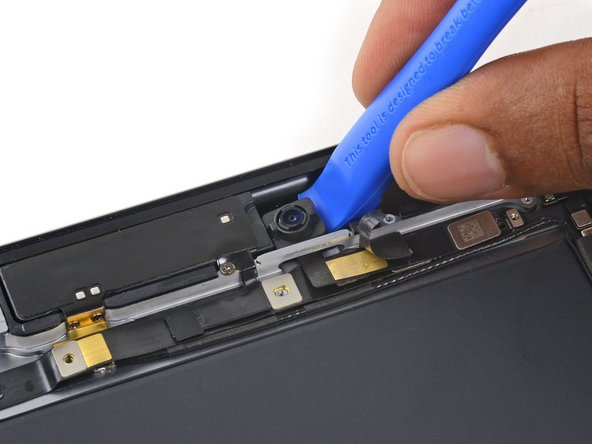 Use a plastic opening tool to pry the front facing camera up from adhesive holding it in the iPad.