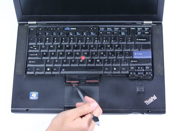The best place to push is on the frame of the keyboard by the power button.