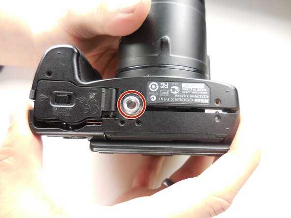 Image 3/3: The tripod attachment may fall out on its own, or you will need to pull it out.