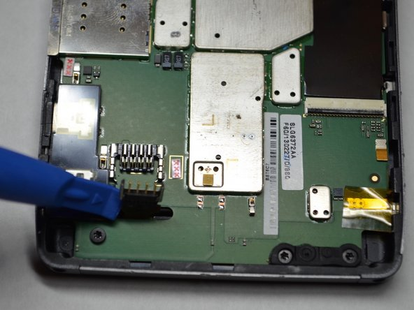Bend the battery cable straight up and out of the way of the motherboard.