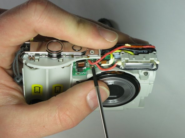Remove the screw holding the flash circuit board in place.