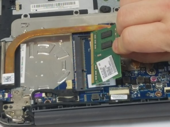 Carefully grab and pull to remove the RAM from your device.