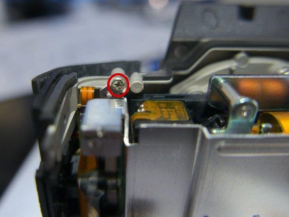 Photo 2: Remove the 2 mm screw in the upper left corner