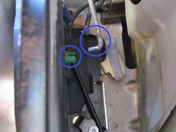 You will also need to pop the inside lock bar off the green clip that it's attached to. This can be done by inserting a flathead screwdriver in between them and turning it sideways.