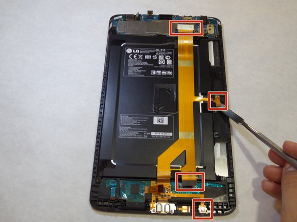 Using a spudger or plastic opening tool, disconnect the ribbon cable from the right side of the device, where it is attached with adhesive.