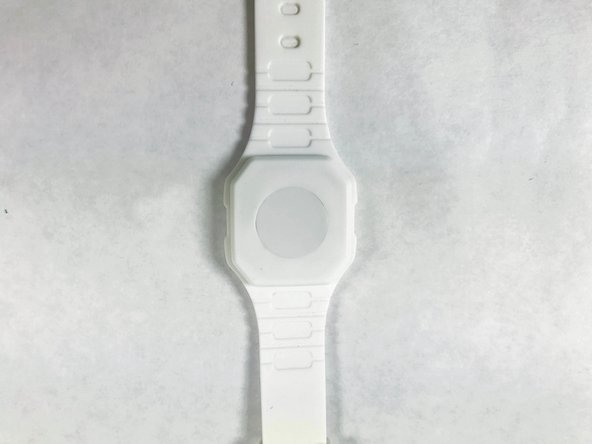 Begin by placing the watch on its backside.