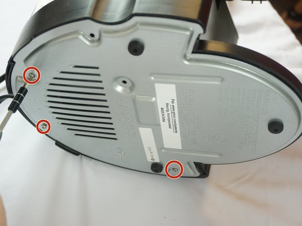 Image 2/2: Begin by unscrewing the five 1.5mm bottom screws with a #0 phillips head screwdriver.