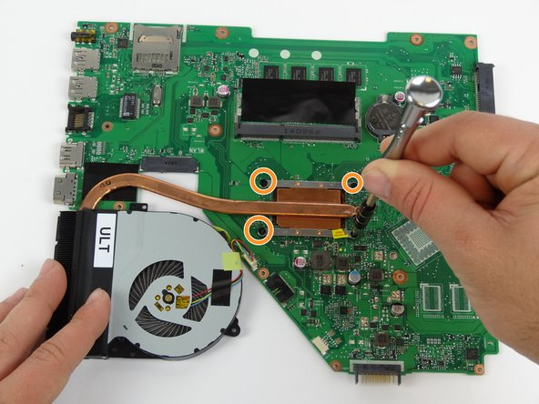 Remove the motherboard and place on a flat surface.