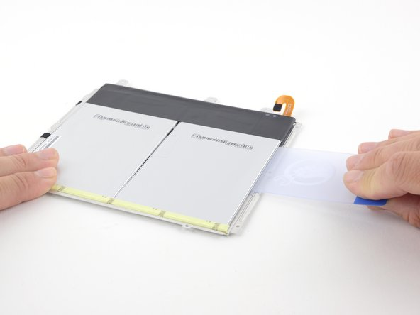 Image 2/2: The adhesive securing the battery to the tray is fairly light, but the battery and tray are so thin that damage may occur during removal.