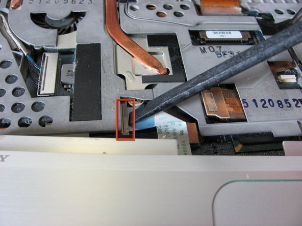 Image 1/2: Lift the ribbon cable lock to remove the cable.