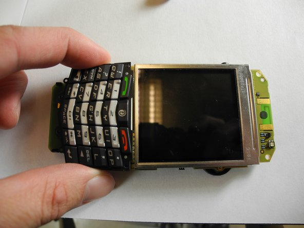 Image 1/2: Flip phone over to the backside.