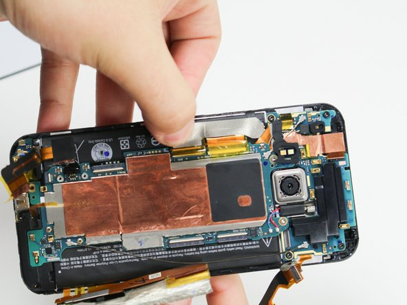 Image 2/3: The third ZIF connector is mostly underneath the motherboard. When reassembling your device, make sure it is placed back underneath.