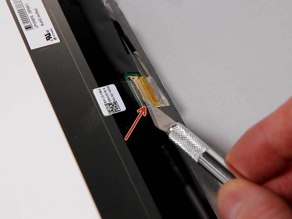 You may need to remove the sticky adhesive tape which holds the connector in place before you can remove it.