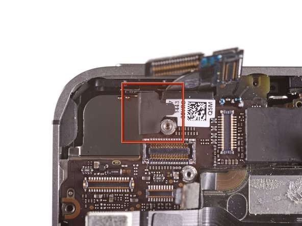 Image 1/2: Remove the 2.6 mm Phillips screw securing the logic board near the power button.
