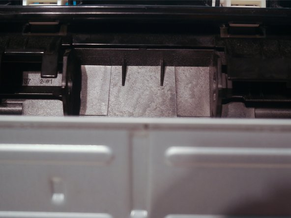 Remove the pickup roller by rotating the white tabs upwards and pulling them outwards.
