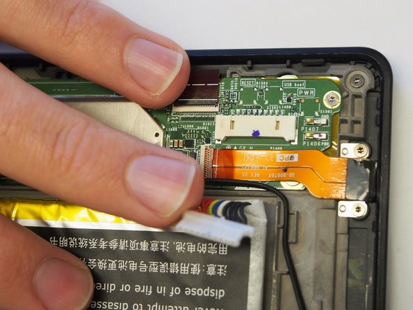 Image 2/2: Use nylon spudger to disconnect the ribbon from the mother board.