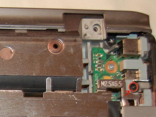 Remove the three screws from the top of the touchpad bezel.