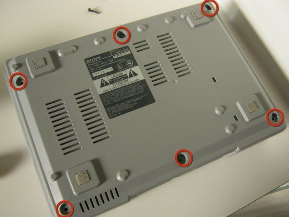 Flip the unit upside down to access the six screws on the bottom.