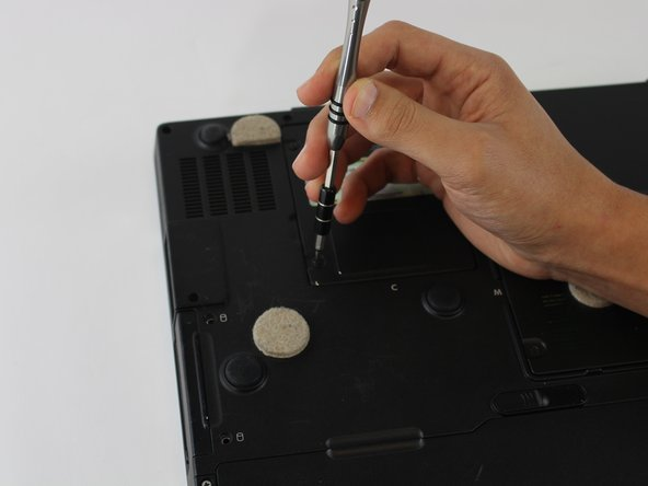 Loosen the screws using a size #0 Phillips screwdriver.