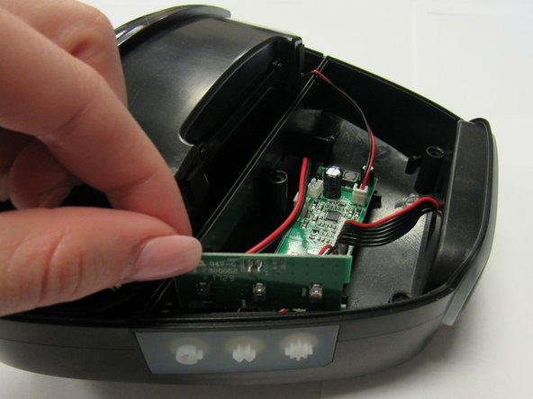 Remove the daughterboard piece from its designated slot, located to the right of the motherboard.
