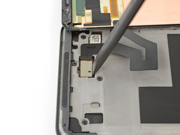 Use the flat edge of a spudger to lift the display cable connector off of its socket.