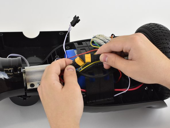 Pull and disconnect the cable connector that is connected to the battery.
