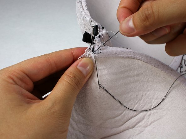 Image 1/3: Near your first incision,  where the knot is, insert the needle into the fabric halfway through.