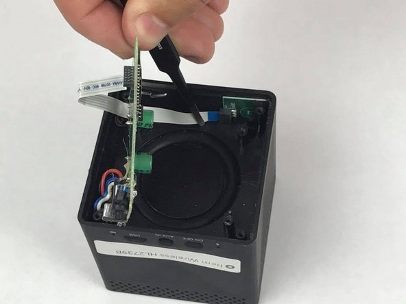 Remove bus wire from the speaker and lift out the motherboard.