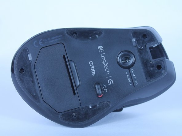 Use a plastic opening tool to peel up the four skates from the bottom of the mouse.