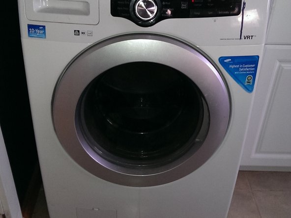 Remove filter from the lower left corner on the front of the washer